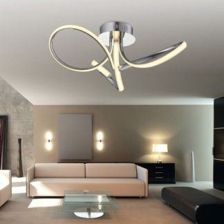 Aranżacja jasnego salonu ze srebrną lampą wiszącą LED