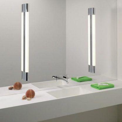 aranżacja kinkietów nowoczesnych przy lustrze w łazience