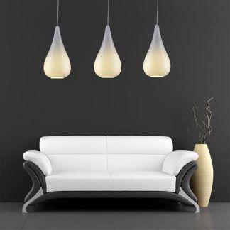 białe duże lampy wiszące do salonu z szarą ścianą