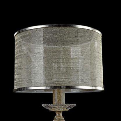brązowa lampa stołowa na drewnianej podstawie