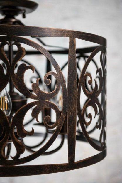 brązowa lampa wisząca ze zdobionymi wzorami