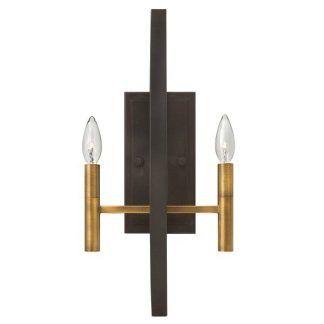 Ciemny metalowy kinkiet ze złotymi świecznikami