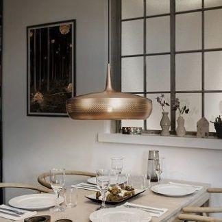 clava dine lampa wiszaca z miedzi nad stół w jadalni