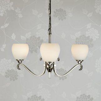 columbia srebrny żyrandol na szarej tapecie w kwiaty