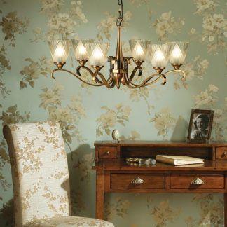 columbia złoty żyrandol na tapecie w kwiaty