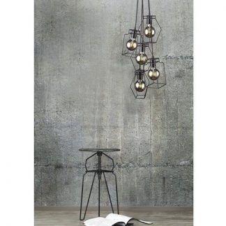 czarna druciana lampa na betonowej ścianie