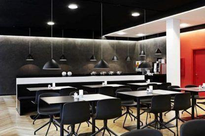czarne lampy wiszące nad stół aranżacja nowoczesna