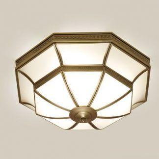 duża lampa sufitowa w złotej ramie szklana