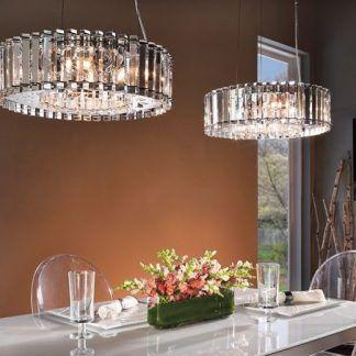 dwie kryształowe lampy nad stołem w jadalni - srebrne