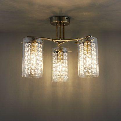 elegancka lampa sufitowa kryształowa do sypialni