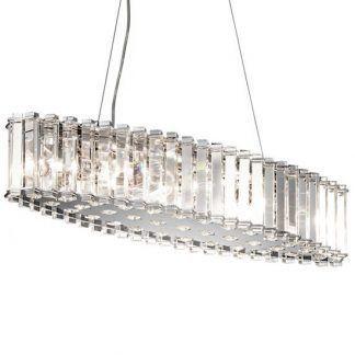kryształowa podłużna lampa wiszaca nad stół w jadalni