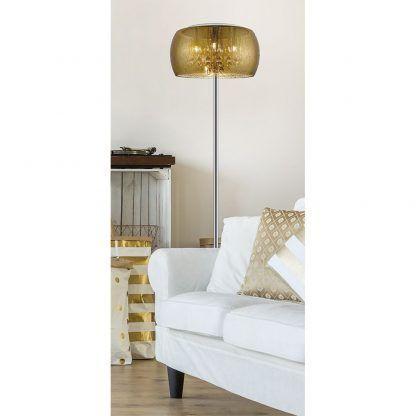 lampa podłogowa do salonu obok białej kanapy - złota elegancka