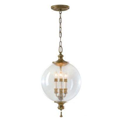 lampa wisząca - duża szklana kula ze świecznikiem w środku