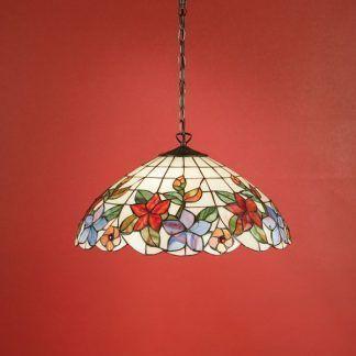 lampa witrażowa w kwiaty na kolorowej ścianie