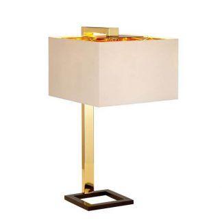 Lampa z geometrycznym jasnym kloszem na złotej podstawie
