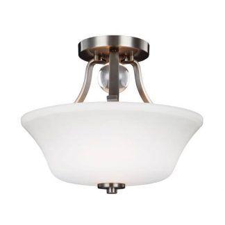 Lampa z mlecznym kloszem na srebrnej podstawie do sypialni