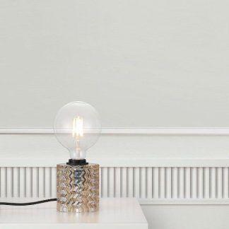 Lampa ze szklaną podstawą bez klosza biały stół