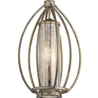 Metalowa lampa w ażurowej zabudowie do sypialni