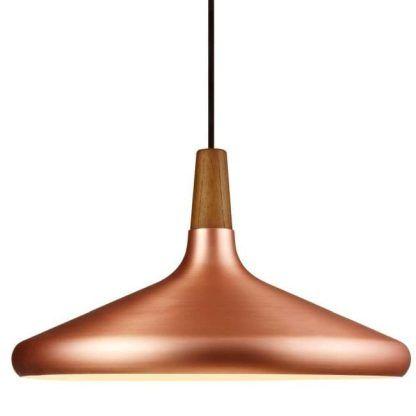 miedziana lampa wiszaca nad stół do jadalni scandi