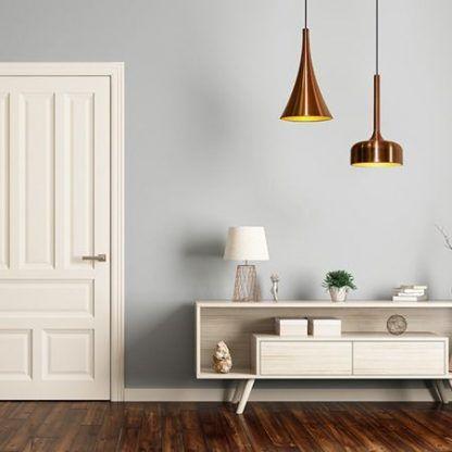 miedziane lampy do jasnego salonu aranżacja