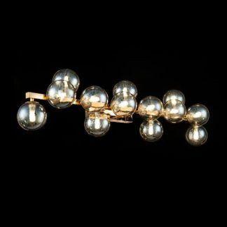 Złoty kinkiet do salonu szklane klosze kule