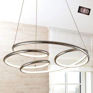 Nowoczesna srebrna lampa wisząca w aranżacji jasnej sypialni