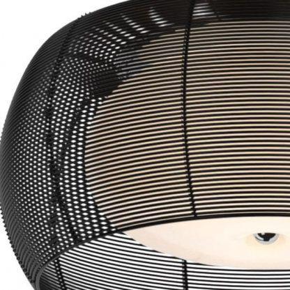 Obudowa okrągła z drucików w kolorze czarnym salon