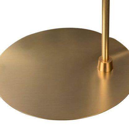 okragła podstawa w lampie złotej