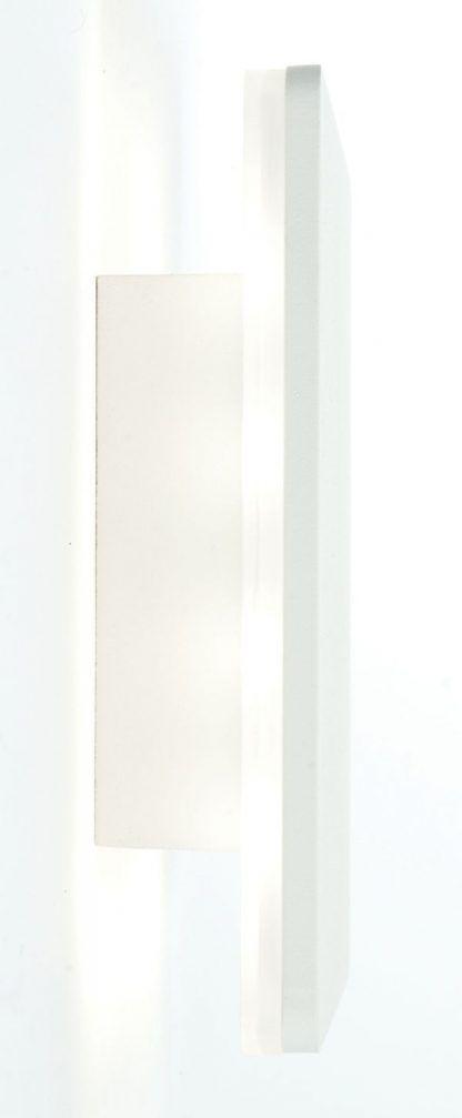 płaski biały kinkiet świecący od spodu do salonu