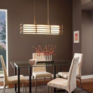Podłużna lampa wisząca nad stołem w jadalni