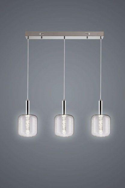 potrójna lampa wisząca do szarej ściany w salonie