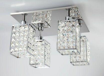 Srebrna lampa z kryształowymi ozdobami do sypialni