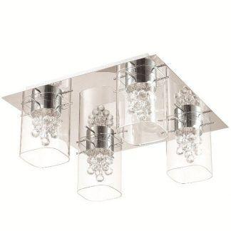 Srebrna lampa ze szklanymi kloszami i kryształkami sypialnia