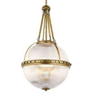 Szklany klosz w kształcie kuli ze złotymi elementami sypialnia