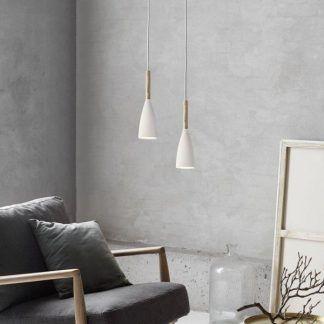 wąskie białe lampy do betonowej ściany