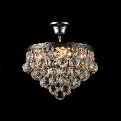 zapalona lampa kryształowa glamour - ciepła barwa