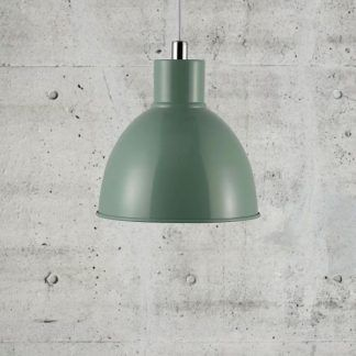 zielona lampa wisząca na betonowej ścianie