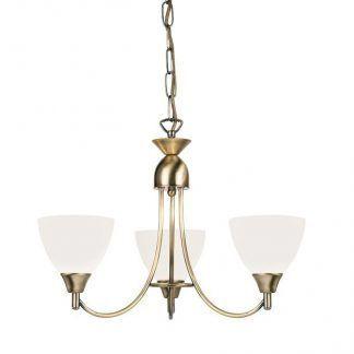 złota lampa sufitowa na trzy żarówki z białymi kloszami