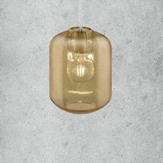 złota lampa wisząca z podłużnym kloszem