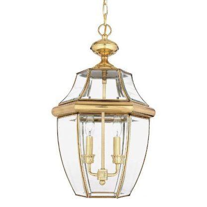 złota lampa wisząca ze szklanym kloszem - wejście do domu
