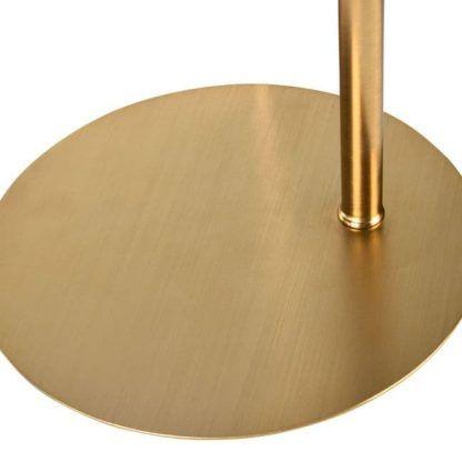 złota podstawa lampy stojącej