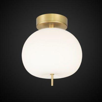 Złota podstawa lampy z okrągłym kloszem
