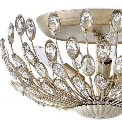 Złote wykończenie okrągłej lampy z kryształkami do salonu
