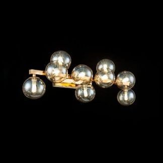 Złoty kinkiet do sypialni szklane klosze kule