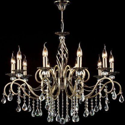 złoty żyrandol świecznikowy do salonu z kryształami