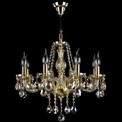 Złoty żyrandol z kryształkami i świecznikami