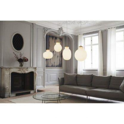 aranżacje oświetlenia w salonie - lampy szklane kule