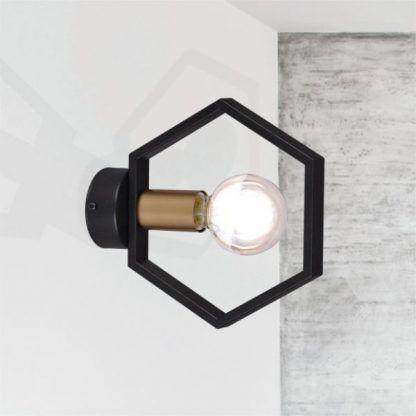 czarny geometryczny kinkiet szara ściana