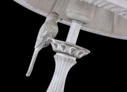 lampa stołowa z figurką ptaszka
