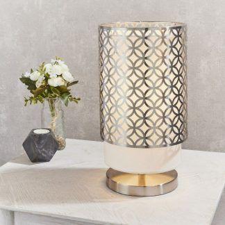 Lampa stołowa Gilli na stolik w eleganckim salonie